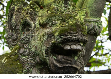 green moss on the stone and brick walls in Bali.  - stock photo