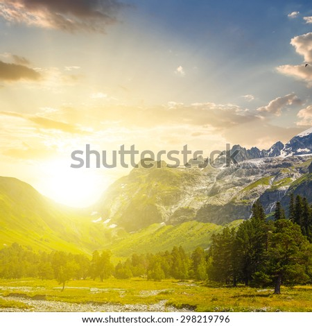 green mountain valley at the sunset - stock photo