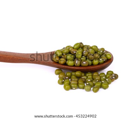 Green mung beans in wood spoon on white background. - stock photo