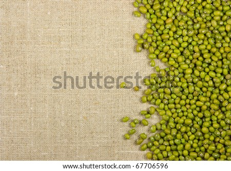 Green mung beans on the burlap background - stock photo