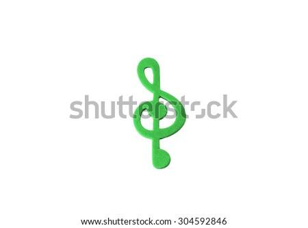 Green music note sheet key on white background - stock photo