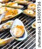 Green Mussel (Perna viridis) on the grill. - stock photo