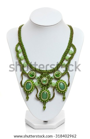 Green necklace on a mannequin isolated on white - stock photo