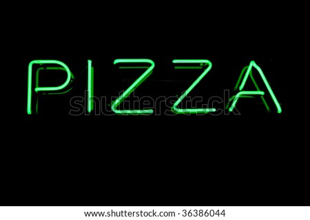 Green Neon Pizza Sign on Black, Copy Space - stock photo