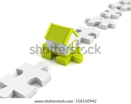 green new house on jigsaw puzzle in row - stock photo