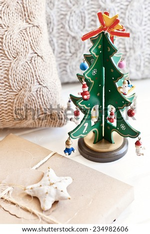 Green new year tree with pillow and present - stock photo
