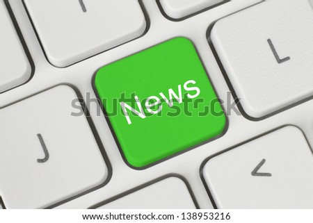 Green news button on keyboard close-up  - stock photo