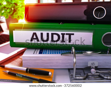 Green Office Folder with Inscription Audit on Office Desktop with Office Supplies and Modern Laptop. Audit Business Concept on Blurred Background. Audit - Toned Image. 3D - stock photo