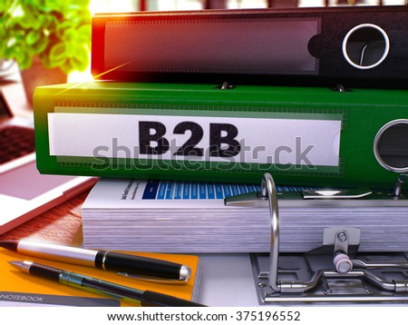 Green Office Folder with Inscription B2B on Office Desktop with Office Supplies and Modern Laptop. B2B Business Concept on Blurred Background. B2B - Toned Image. 3D - stock photo