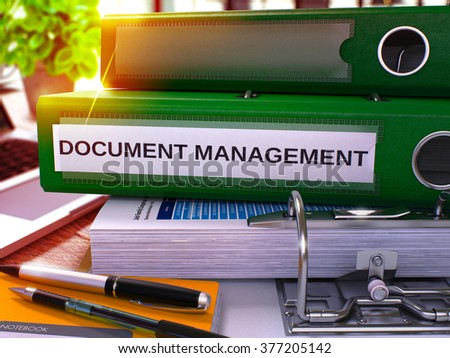 Green Office Folder with Inscription Document Management on Office Desktop with Office Supplies and Modern Laptop. Document Management Business Concept on Blurred Background. 3D Render. - stock photo