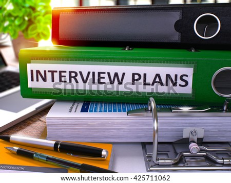 Green Office Folder with Inscription Interview Plans on Office Desktop with Office Supplies and Modern Laptop. Interview Plans Business Concept on Blurred Background. 3D Render. - stock photo