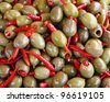 Green olive fruits stuffed with red pepper - stock photo