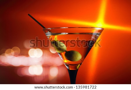green olives in glass with martini ,focus on a olives
