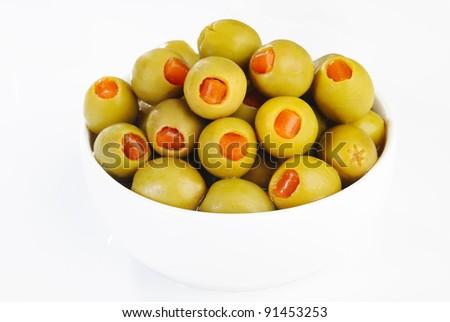 green olives on white bowl - stock photo