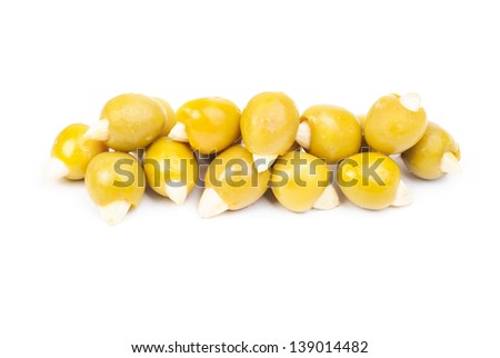 Green olives stuffed with almonds  isolated on white  background