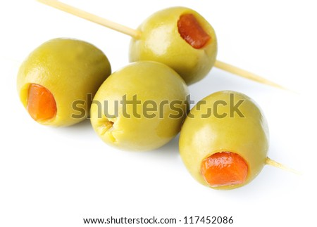 green olives stuffed with pepper on white background - stock photo
