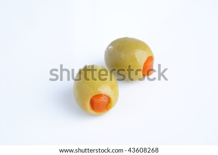 green olives stuffed with pepper on white background