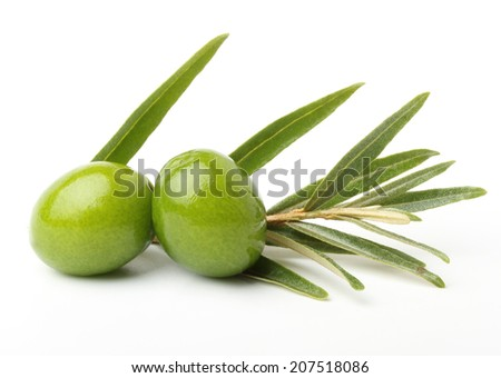 Green olives with leaves isolated on white - stock photo