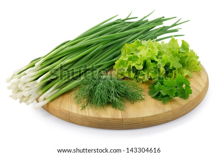 Green onions with herbs on the board isolated on white background - stock photo