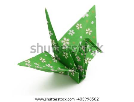 Green Origami Crane isolated on white background - stock photo