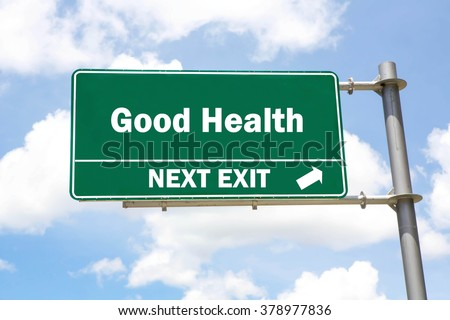 Green overhead road sign with a Good Health Next Exit concept against a partly cloudy sky background. - stock photo