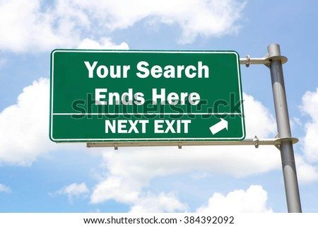 Green overhead road sign with a Your Search Ends Here Next Exit concept against a partly cloudy sky background. - stock photo