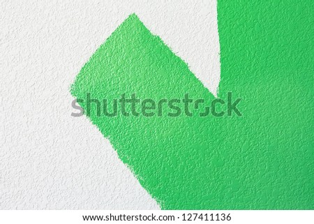 green paint on a wall - stock photo