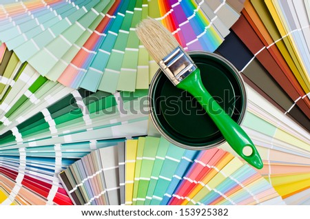 Green paint sample. Swatches with different shades of green and can of green paint with brush. - stock photo