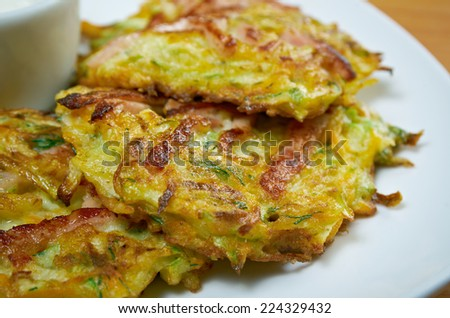 Green pancakes with zucchini and herbs.close up