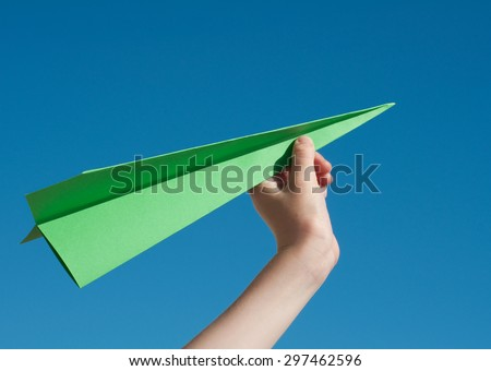 Green paper aeroplane - Green travel concept - stock photo