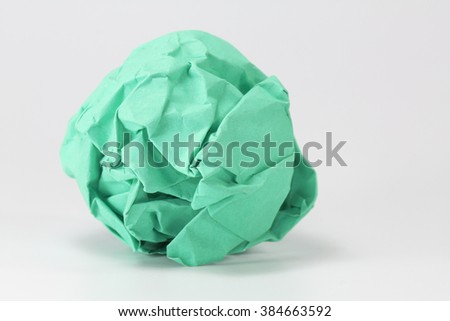 green paper balls on gray background selective focus with shallow depth of field