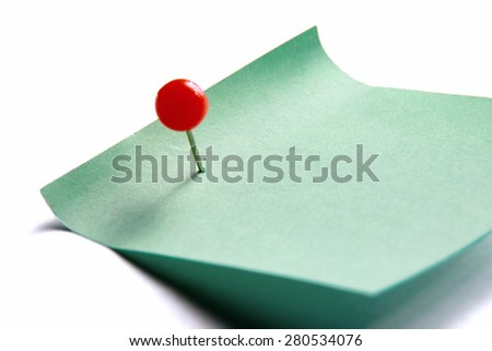 Green paper note on white background isolated. - stock photo