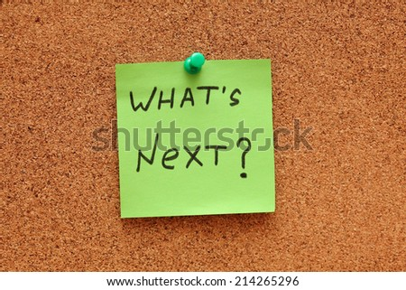"Green paper note saying ""What's next?"" on corkboard (bulletin board). Closeup. - stock photo"