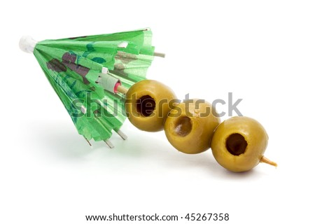 green paper umbrella and olives - stock photo