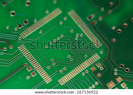 Green PCB (close-up shot) for use as background image or as texture - stock photo