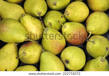 Green pears at a farmers market in France - stock photo