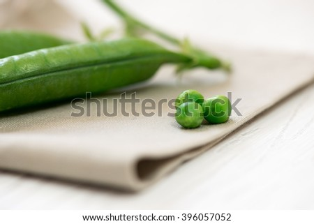 Green peas and pods, close-up. - stock photo