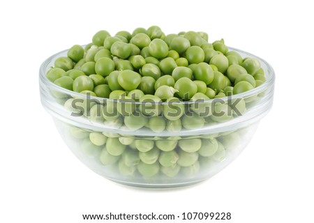 Green peas in a glass bowl. isolated on a white background