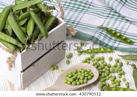 green peas in a wooden box
