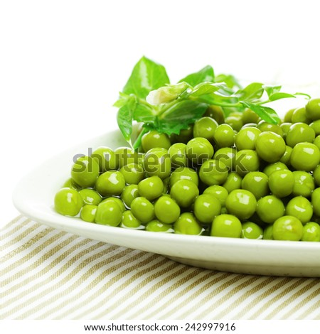 Green peas on plate, food ingredient background - stock photo