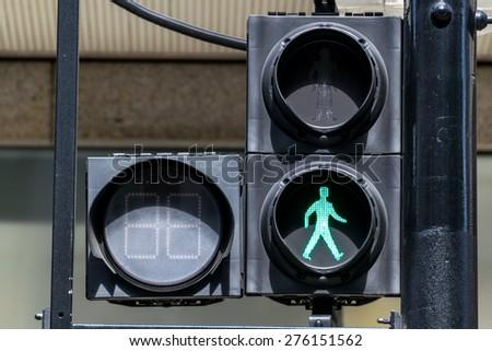 GREEN pedestrian traffic lights under sunlight - stock photo