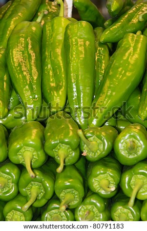 green peppers in a market