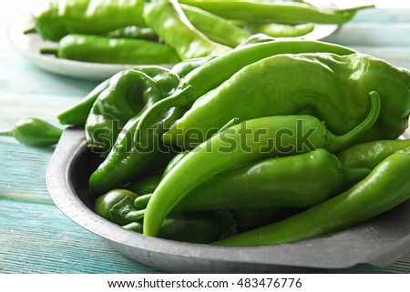 Green peppers on metal plate, closeup