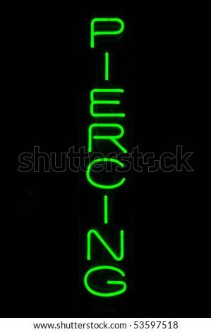 Green Piercing Neon Sign Light against black - stock photo