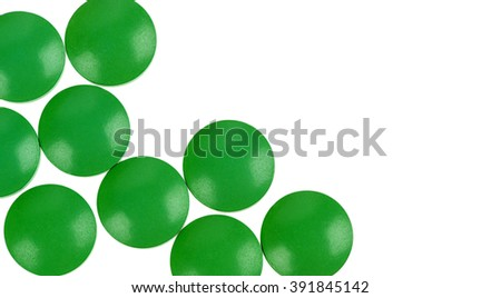 green pills isolated on white background