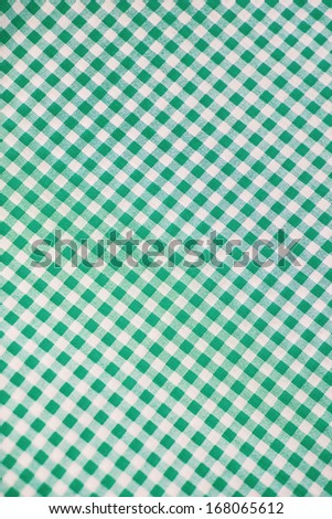 Green plaid fabric as background - stock photo