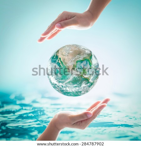 Green planet among female human hands on turquoise blue water background : World ocean and environment protection concept: Saving CSR healthy oceans and planet: Element of the image furnished by NASA  - stock photo