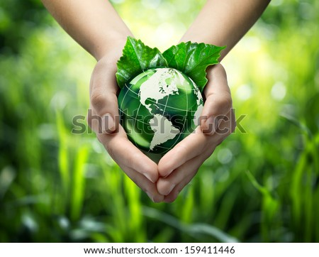 Green planet in your heart hands - usa - environment concept  - stock photo