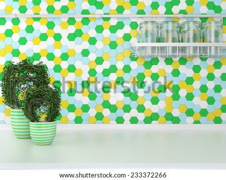 Green plants on the white worktop. Glass kitchenware on the cupboard. - stock photo