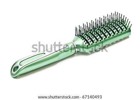 Green plastic comb isolated on white background - stock photo